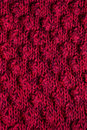 Texture Of Knitted Dark Pink Scarf Royalty Free Stock Images - 49701549