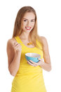 Attractive Woman Eating Cereals. Stock Photography - 49712922