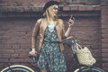 Hipster Girl With Bike And Phone Royalty Free Stock Photos - 49719108