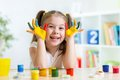 Beautiful Child Girl With Hands In Color Paints Stock Photo - 49740600