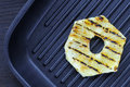 Fried Pineapple On The Grill. Cooking Fish Burger. Stock Images - 49759574