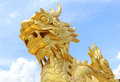 Golden Dragon Statue In Vietnam Over Blue Sky Royalty Free Stock Photography - 49785987