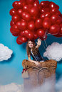 Small Cute Girl Flying On Red Heart Balloons Valentines Day Royalty Free Stock Photography - 49805587