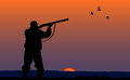 Hunter With Gun At Sunset Background Stock Image - 49821501