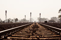 Distant Man Walking On Railway Track Stock Photography - 49828142