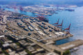 Tilt Shift Of Shipping Port With Containers And Loading Transport Ship With Cargo Royalty Free Stock Images - 49833539
