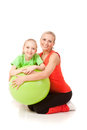 Little Girl Doing Exercise With An Instructor Royalty Free Stock Photo - 49843655