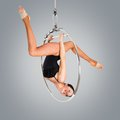 Plastic Beautiful Girl Gymnast On Acrobatic Circus Ring In Flesh-colored Suit Stock Photography - 49857762