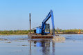 Excavator Working In The River Stock Photo - 49865680