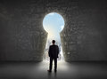 Business Man Looking At Keyhole With Bright Cityscape Concept Royalty Free Stock Image - 49870576