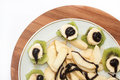 Fruit Salad With Banana And Kiwi Topped With Chocolate Cream Royalty Free Stock Image - 49882066
