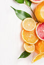 Citrus  Juice And Sliced  Fruits: Orange, Lemon And Grapefruit On White Wooden Royalty Free Stock Photography - 49882537
