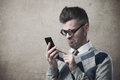 Funny Guy Having Troubles With His Smartphone Royalty Free Stock Photos - 49885418