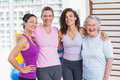 Happy Women Standing Arms Around In Gym Royalty Free Stock Photo - 49894185