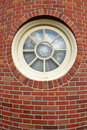 Round Window In A Brick Tower Stock Photography - 4995422