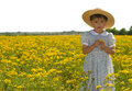 Young Child In Field Of Yellow Flowers Royalty Free Stock Image - 4999866