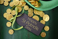 St Patricks Day Leprechaun Hat With Gold Chocolate Coins Stock Photos - 49900333