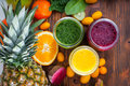 Blended Green,yellow And Purple Smoothie With Ingredients Stock Photos - 49963303