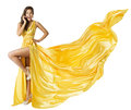 Woman Beauty Fashion Dress, Beautiful Girl In Flying Yellow Fluttering Gown, Standing On One Leg High Heels, Fabric Cloth Waving Royalty Free Stock Photo - 49995375