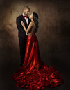 Couple In Love, Lovers Woman And Man, Glamour Classic Suit And Dress With Long Tail, Fashion Beauty Portrait Of Young Models Stock Image - 49995761