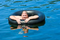 Man In Water With Tube Stock Image - 5002811