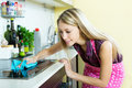 Maid Cleans Modern Stove Royalty Free Stock Photo - 50012365