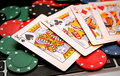 Poker Chips And Four Kings On Laptop Royalty Free Stock Photo - 50017585