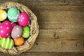 Easter Eggs In Nest On Wood Royalty Free Stock Image - 50019446