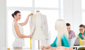 Smiling Fashion Designers Working In Office Royalty Free Stock Photography - 50049567