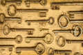 Different Antique Keys On A Wooden Background Stock Images - 50054684