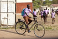 Student Riding Bicycle In Africa Royalty Free Stock Images - 50091009
