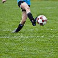 Kicking Soccer Ball Royalty Free Stock Photography - 5014867