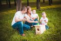Happy Family With Nesting Box And Paints Royalty Free Stock Photo - 50108865
