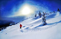 Skier Skiing Downhill In High Mountains Against Sunset Royalty Free Stock Images - 50141429