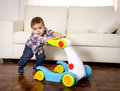 Sweet Little Boy Playing Alone With Baby Walker Taking His First Steps Excited And Playful Royalty Free Stock Photo - 50157385