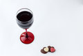 Overhead View Of A Glass Of Wine With Two Heart Chocolates. Stock Photo - 50157640