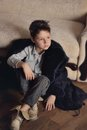 Boy In A Fur Coat Stock Photography - 50178532