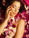 Beauty Young Brunette Woman With Flower Close Up Stock Photo - 50182300