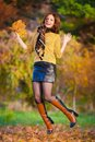 Woman In Beige Sweater And Black Leather Skirt Jump Stock Photos - 50190173