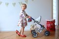 Preschooler Girl Playing With Doll And Pram Stock Photo - 50192170