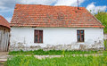 Simple White Farmhouse With A Red Roof Stock Images - 50207744