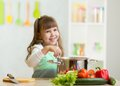 Kid Girl Playing Cook And Makes A Dinner Stock Photo - 50222110