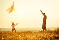 Dad With His Daughter Let A Kite Stock Photos - 50228663