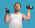 Man Exercising With Dumbbells Royalty Free Stock Image - 50237426