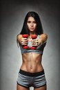 Sports Young Woman With Dumbbells Royalty Free Stock Image - 50247716