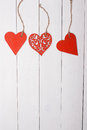 Three Wood Hearts On A Wooden Table Stock Image - 50249941