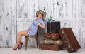 Pregnant Tourist With Suitcases Stock Photos - 50254163