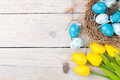 Easter Background With Colorful Eggs And Yellow Tulips Stock Image - 50261301