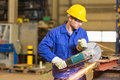 Steel Construction Worker Cutting Metal With Angle Grinder Stock Photography - 50289622
