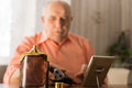 Aftershave Bottle In Front Old Bald Man Stock Photos - 50308413